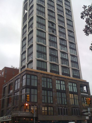 Above the base, the building's facade undulates to suggest balconies.