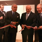 Italian Trade Commission President Umberto Vattani cuts ribbon with Cosmit President Carlo Gugliemi and Federlegno-Arredo President Rosario Messina.