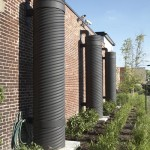 Three rainwater collection tanks can store 240 cubic feet of runoff that's reused reused for landscape irrigation. (Ted Wathen/Quadrant)