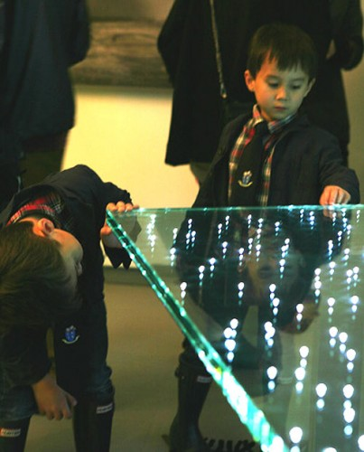 Future Maurer collectors ponder the LED Table. (2 panels for $38,000) (Photo by Tom Stoelker)