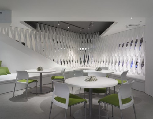 Entitled The Body, a feature wall, encloses a cafe (Shimoda Design)