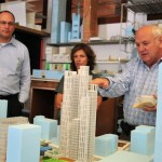 Jeanne Gang, center, shows a model of her design for CentrePointe to developer Dudley Webb, right, and structural engineer Ron Klemencic (Courtesy Studio Gang)