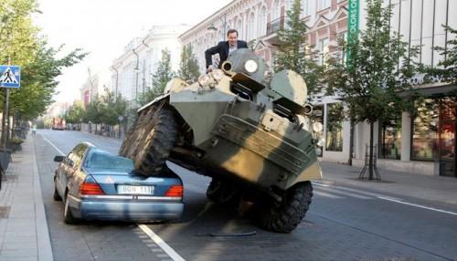 Mayor of Vilnius, Lithuania crushing a car in the bike lane. (Video still)