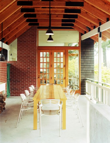 A covered porch extends the outdoor dining season for up to ten guests. Courtesy Tom Fowlks