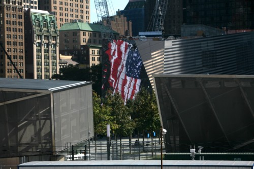 The flag from One World Trade as reflected in Snohetta's Memorila Museum Pavilion. (AN/Stoelker)