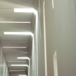 Light slits continue from the vertical to horizontal surface along panel seams (SUMO)
