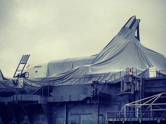 Protective tent around the Space Shuttle Enterprise in tatters. (Brian Harmon / Twitter)
