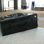 """The sculpture's second component, a """"vortical suitcase"""" on the atrium floor, was handcrafted from granite and bronze in China (Kreysler & Associates)"""