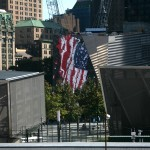 A flag reflected on glass at the World Trade Center site on September 11.