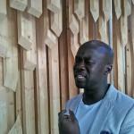 David Adjaye with his pavilion. (AN / Julie Iovine)