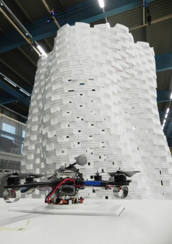 A robot in front of a prototype tower. (Courtesy Gramazio & Kohler and Raffaello D'Andrea with ETH Zurich)