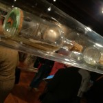 The museum's ship-in-a-bottle collection is displayed in a series of plexi tubes.