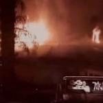 Ken Kellogg's building on fire. (Screenshot from KESQ video)