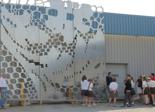 Students from St. Theresa check out the facade panel.