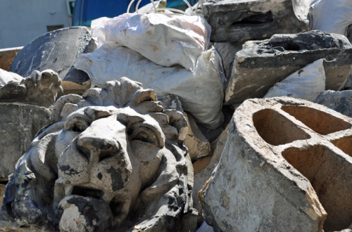 The lion's heads that once graced the cornice of 4195 Broadway. (Courtesy Trish Mayo)