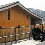 Wang Shu in front of his New Academy of Art HangZhou, China. (Iwan Baan)