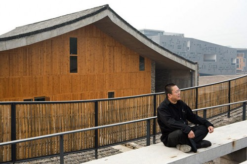 Wang Shu in front of his New Academy of Art HangZhou, China. (Iwan Baan)