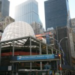 The oculous of the Grimshaw-designed Fulton Transit center sits within the square curtain wall.