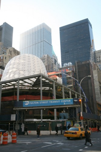 The oculus of the Grimshaw-designed Fulton Transit Center sits within the square curtain wall.