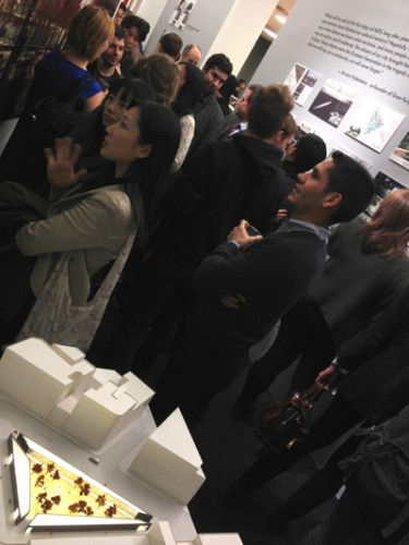 The crowd at the Center with studio a+i's model in foreground.