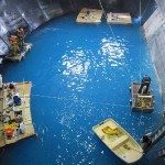 Installers finished their work from floating platforms (Monterey Bay Aquarium)