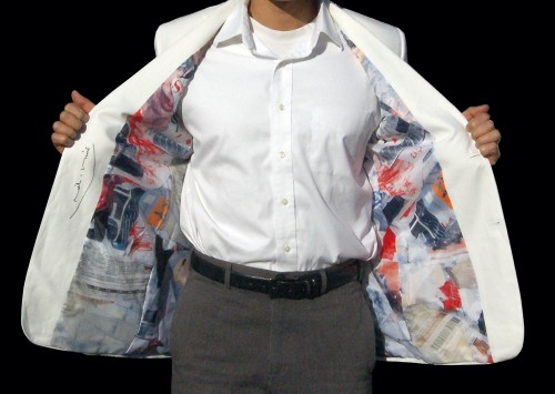 Richard Meier's white linen blazer has a colorful and chaotic collage lining.
