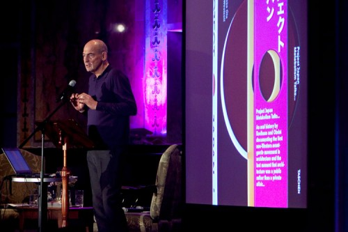 Rem Koolhaas in front of an image of his book Project Japan: Metabolism Talks. (Jori Klein)
