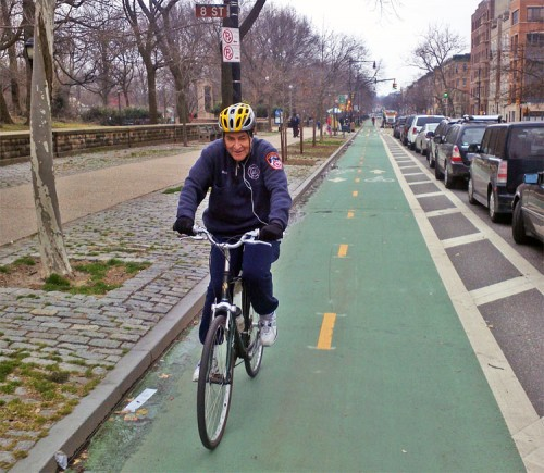 Senator Chuck Schumer rides on Prospect Park West. (Paul Steely White)