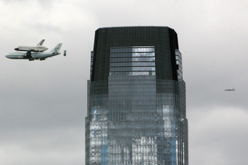 The shuttle and a fighter jet fly past Pelli's Goldman Sachs tower in Jersey City. (AN/Stoelker)