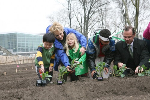 Battery Park's Warrie Price and the commissioner plant broccoli at an urban farm in Battery Park