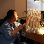 A staff member completes the physical model, used to determine the path of each rope (Clifford Ho)