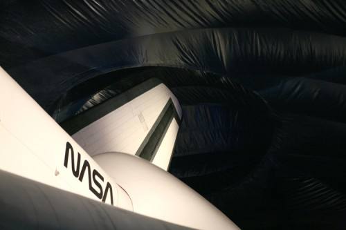 The shuttle's tail protrudes up into the pavilion.