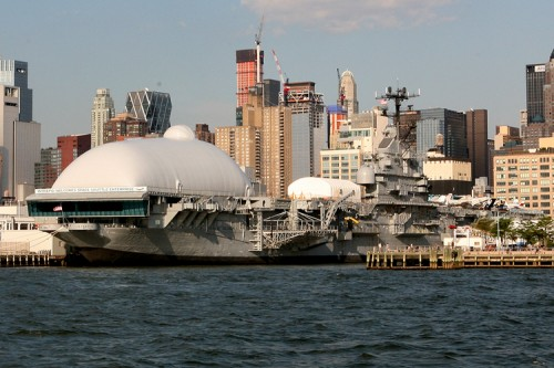 The Intrepid's bulbous temporary addition as seen from the river.