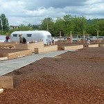 An Airstream trailer repurposed as a tool shed sits among the planting beds. (Courtesy UpGarden P-Patch)