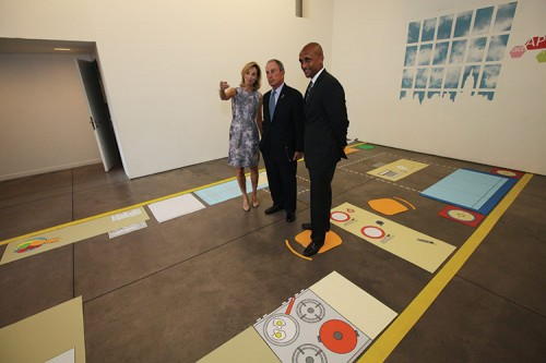 HPD Deputy Wambua, Mayor Bloomberg, and Economic Development Deputy Steel stand in a spatiall6 accurate visualization of a possible Micro-Apartment layout for New York City's Kips Bay competition. (Courtesy of NYC Mayor's Office)