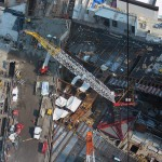 A crane rises from the WTC transit hub site.