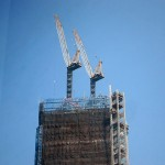 Two cranes at the top of One World Trade.