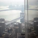 Reflecting bridges in the facade of Four World Trade.