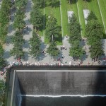 Visitors surround the fountain at the September 11 Memorial Plaza.