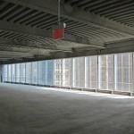 An 80-foot column-free expanse of glass inside Four World Trade.