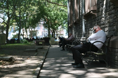 A lunchtime snooze in a graveyard just across the street from the World Trade Center Memorial. (AN/Stoelker)