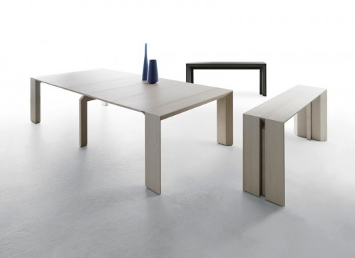 The Minuetto table transitions from a side table to a ten-seater dining table.