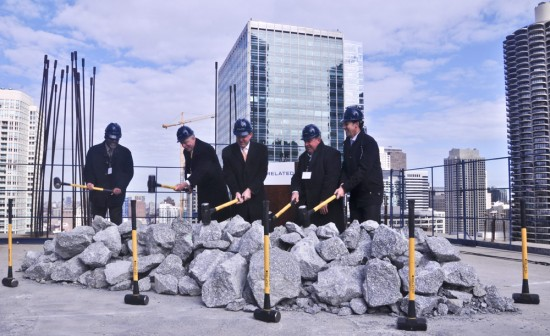 "Developers, construction workers, and 42nd ward ald. Brendan Reilly break ""ground"" on the 28th floor of the Waterview Tower. (Chris Bentley / The Architect's Newspaper)"