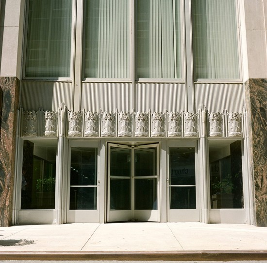 Art-Deco detailing at a side entrance to 70 Pine. (12th St David / Flickr)