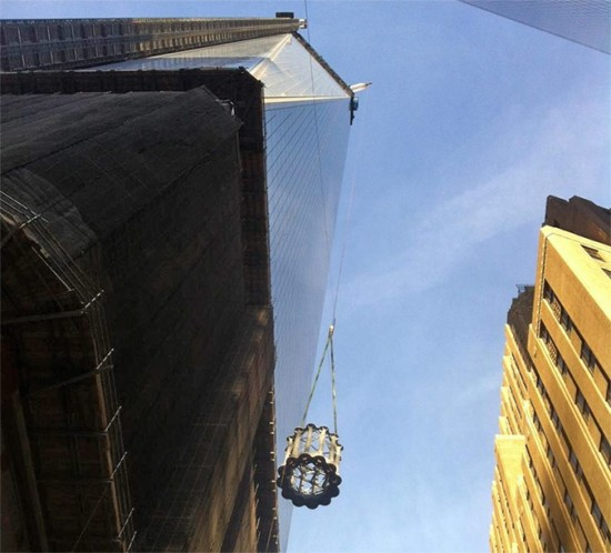 Antenna segments being hoisted to the top of One World Trade. (Courtesy Port Authority of NY & NJ)