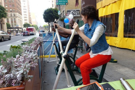 Enjoying one of the parklet's exercise bikes. (Siobhan Burke)