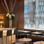 A metal screen installed in the window of Le Bernardin's new lounge provides privacy from the street. (Daniel Krieger)