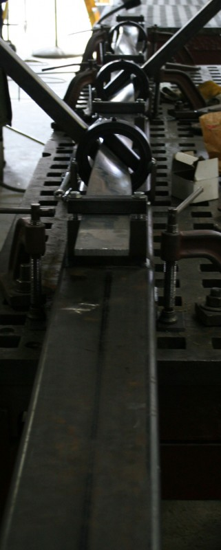 The machine that Veyko developed allowed its technicians to lay a bar of metal down for twisting and bending without ever having to take the piece out of the machine. (William Baggot)