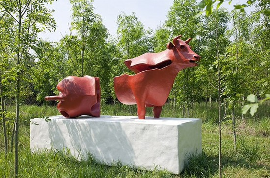 Cow sculpture by Atelier Van Lieshout.