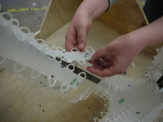 Each piece of the plastic casing is connecting by a series of tabs. (Kenneth Tracy)